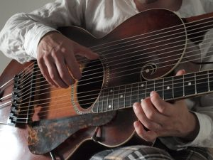 my hands and my Gibson Style U harp guitar